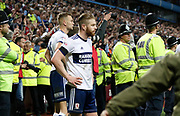 Ben Gibson of Middlesbrough and Adam Clayton of Middlesbrough watch the pitch invasion after applauding the Middlesbrough fans at full time, during the EFL Sky Bet Championship match between Aston Villa and Middlesbrough at Villa Park, Birmingham, England on 15 May 2018. Picture by Paul Thompson.