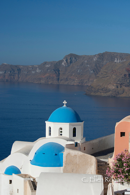 A blue domed church and bell tower in Oia, Santorini, The Cyclades, The Aegean, The Greek Islands, Greece, Europe