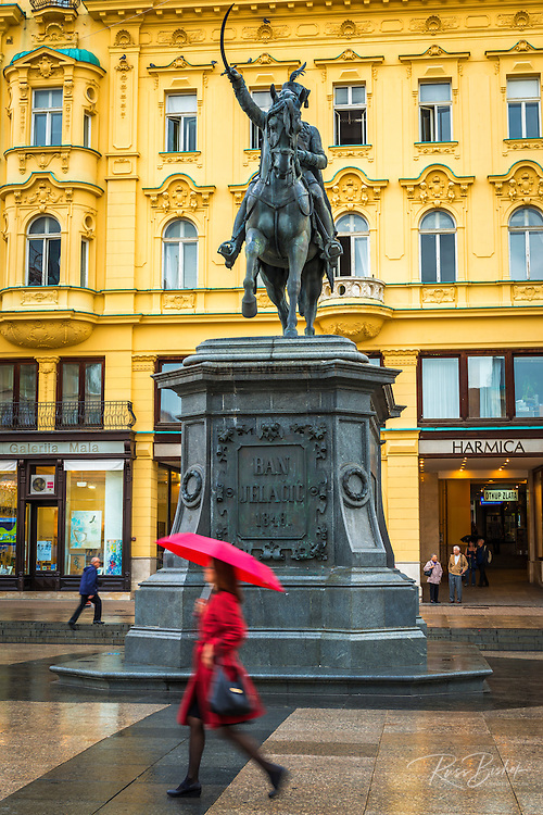 Josip Jelacic Statue and woman with red umbrella, Jelacic Square, Zagreb, Croatia