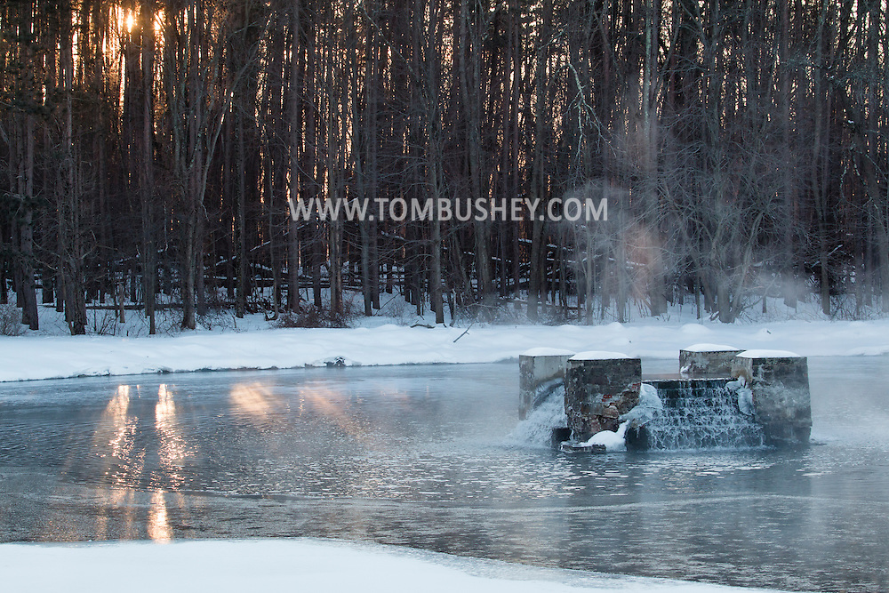 Middletown, New York - Steam rises from the water at Monhagen Reservoir on a cold February morning. The temperature was arond zero.
