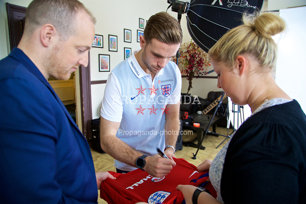 LIVERPOOL, ENGLAND - Wednesday, May 17, 2017: Liverpool and England's Jordan Henderson signs an England shirt during a photoshoot for Vauxhall at the Devonshire House Hotel. (Pic by David Rawcliffe/Propaganda)