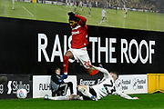 Djed Spence (29) of Middlesbrough leaps over Joe Bryan (23) of Fulham during the EFL Sky Bet Championship match between Fulham and Middlesbrough at Craven Cottage, London, England on 17 January 2020.