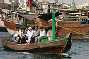 Small wooden passenger ferry in Dubai Creek, Dubai, United Arab Emirates.