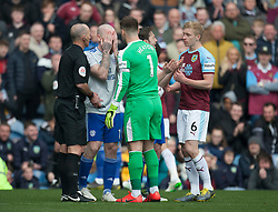 Aron Gunnarsson of Cardiff City (C) looks dejected as Referee Mike Dean overturns a penalty decision - Mandatory by-line: Jack Phillips/JMP - 13/04/2019 - FOOTBALL - Turf Moor - Burnley, England - Burnley v Cardiff City - English Premier League