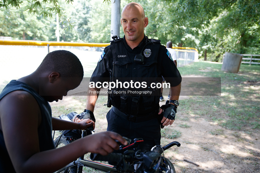 2017 July 08: Chapel Hill Police Department and Orange County Sheriff at the Marcus Ginyard basketball camp Chapel Hill Community Day at Hargraves Community Center in Chapel Hill, NC. (Photo by Peyton Williams)