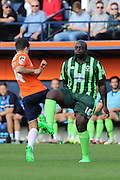 Bayo Akinfenwa of AFC Wimbledon and Jonathan Smith during the Sky Bet League 2 match between Luton Town and AFC Wimbledon at Kenilworth Road, Luton, England on 26 September 2015. Photo by Stuart Butcher.