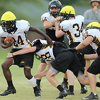 Itawamba AHS running back turns the corner running the ball during practice Friday afternoon in Fulton.