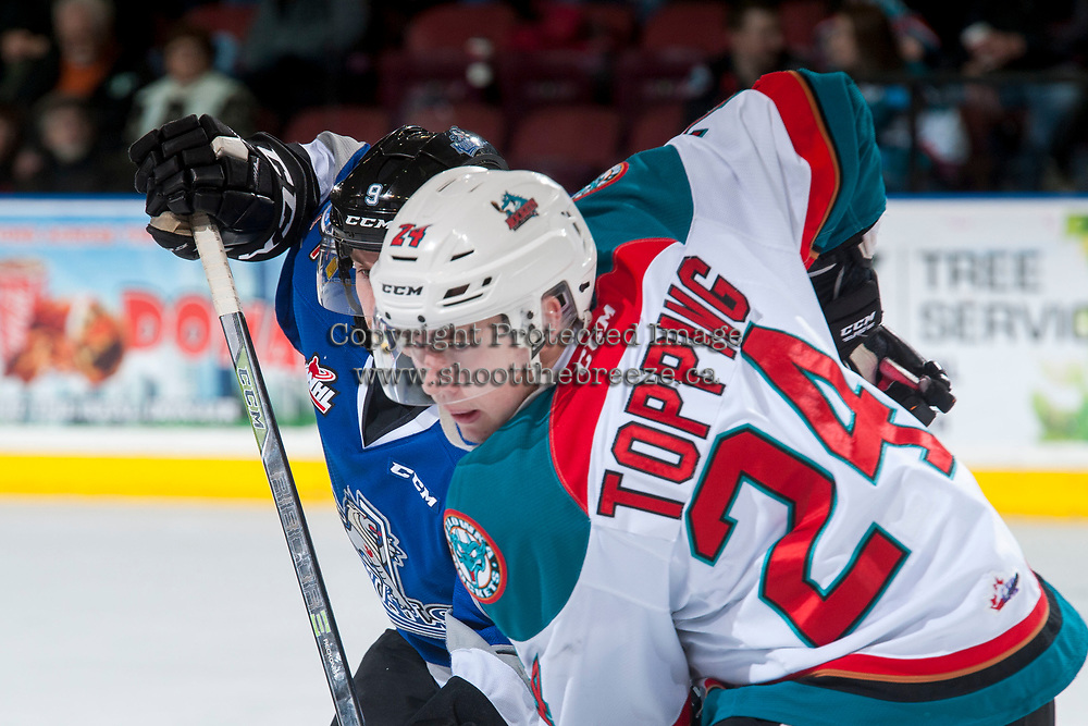 KELOWNA, CANADA - MARCH 7: Kyle Topping #24 of the Kelowna Rockets checks Jack Walker #9 of the Victoria Royals on March 7, 2017 at Prospera Place in Kelowna, British Columbia, Canada.  (Photo by Marissa Baecker/Shoot the Breeze)  *** Local Caption ***