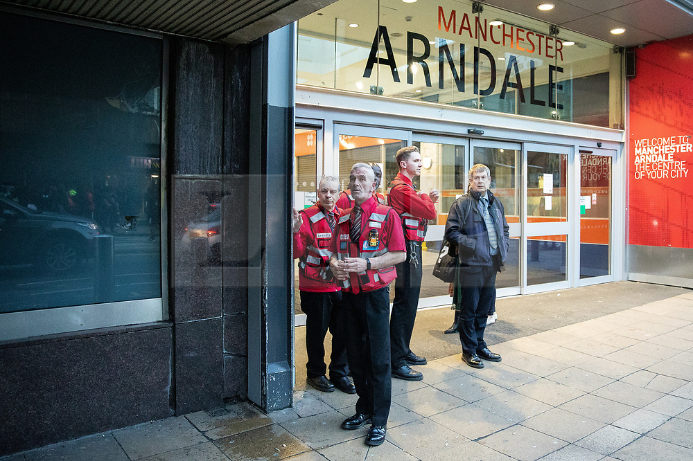 © Licensed to London News Pictures. 04/10/2019. Manchester, UK. Security block the entrance to the Arndale Centre . GMP responded to an incident at the Arndale Centre in Manchester City Centre at which batons and CS gas were deployed against school children . GMP say they have arrested two 16 year olds on suspicion of having committed public order offences . Photo credit: Joel Goodman/LNP
