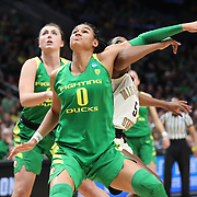 March 31, 2019; Portland, OR, USA; Oregon Ducks forward Satou Sabally (0) blocks out Mississippi State Bulldogs in the first half of Elite Eight of the NCAA Women's Tournament at Moda Center.<br /> Photo by Jaime Valdez