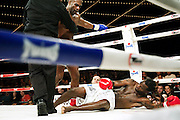 Madison Square Garden hosts it's first ever Muay Thai fight event, New York, New York, March 16, 2012. Sean Hinds, left, knocks down Deshawn Robinson, right. Fight was called a draw (professional Muay Thai bout).