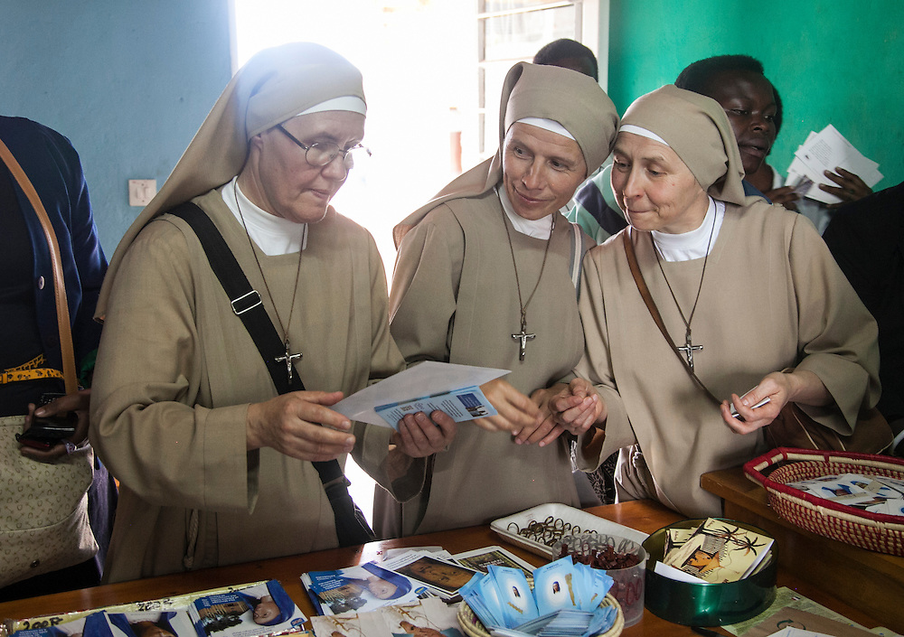 (Left to right): Sister Fabiana, Sister Bogumira and Sister Agnes, Franciscan nuns from Poland who live in Rwanda, look over items at the The Shrine of Our Lady of Sorrows gift shop in Kibeho, Rwanda. This is the only sanctioned Marian sanctuary in Africa. Kibeho's overseers and the Rwandan government hope this place will become a top tourism site. Three young Rwandan women had visions of the Virgin Mary, the very first vision coming to Alphonsine Mumureke, then 16, on Nov. 28, 1981.<br /> <br /> Photographed on Sunday, October 26, 2014.<br /> <br /> Photo by Laura Elizabeth Pohl