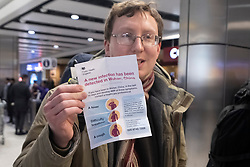 © Licensed to London News Pictures. 22/01/2020. London, UK.British passenger Robert Cosby speaks to the media at Heathrow airport arriving on China Southern Airlines flight CZ673 from Wuhan arrives in London. He is holding a government health warning. The Coronavirus virus has originated in the Wuhan region. Photo credit: Ray Tang/LNP
