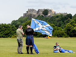 Pictured: Marcher readies his banner with Stirling Castle in the background.<br /> <br /> An estimated 7000 people marched through Bannockburn near Stirling in support of Scottish independence, in the latest march organised by the 'All Under One Banner' group.<br /> <br /> © Dave Johnston / EEm