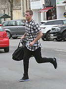 02.MARCH.2014. ESSEX<br /> <br /> CODE - MAG<br /> <br /> TOWIE AND SPLASH STAR DAN OSBOURNE SEEN MAKING A QUICK DASH TO A CLOTHES SHOP IN EPPING, ESSEX SO HE CAN GET CHANGED FOR FILMING AS HE WAS RUNNING LATE. DAN WAS SEEN RUNNING ACROSS THE HIGH STREET AND HEADED INTO THE SHOP WHO KINDLY ALLOWED DAN TO CHANGE AND IRON HIS BLACK SHIRT FOR HIM<br /> <br /> BYLINE: EDBIMAGEARCHIVE.CO.UK<br /> <br /> *THIS IMAGE IS STRICTLY FOR UK NEWSPAPERS AND MAGAZINES ONLY*<br /> *FOR WORLD WIDE SALES AND WEB USE PLEASE CONTACT EDBIMAGEARCHIVE - 0208 954 5968*