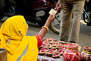 Woman selling lamps for Diwali at Jaipur's old town