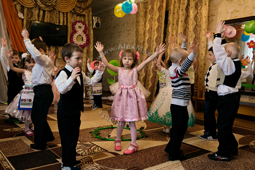Children at a kindergarten in Myronivs'kyi, a small town near the frontline of eastern Ukraine, are performing a play to celebrate women's day and the coming of spring.