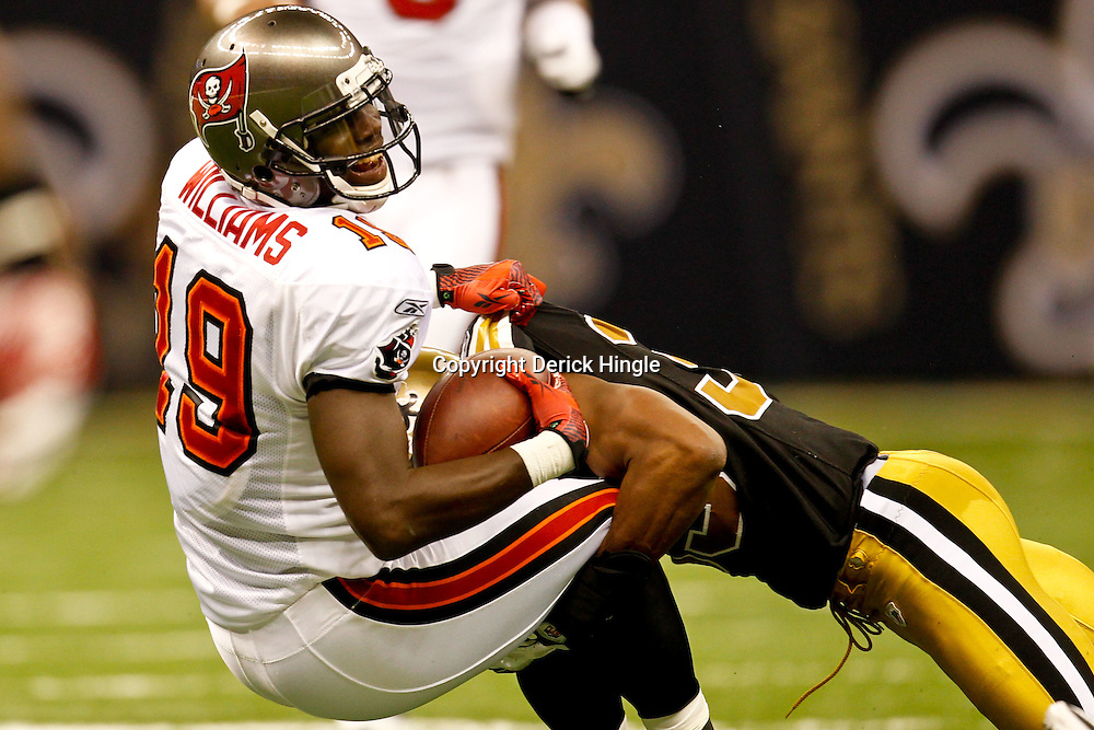 November 6, 2011; New Orleans, LA, USA; Tampa Bay Buccaneers wide receiver Mike Williams (19) is tackled by New Orleans Saints cornerback Jabari Greer (33) during the third quarter of a game at the Mercedes-Benz Superdome. The Saints defeated the Buccaneers 27-16. Mandatory Credit: Derick E. Hingle-US PRESSWIRE