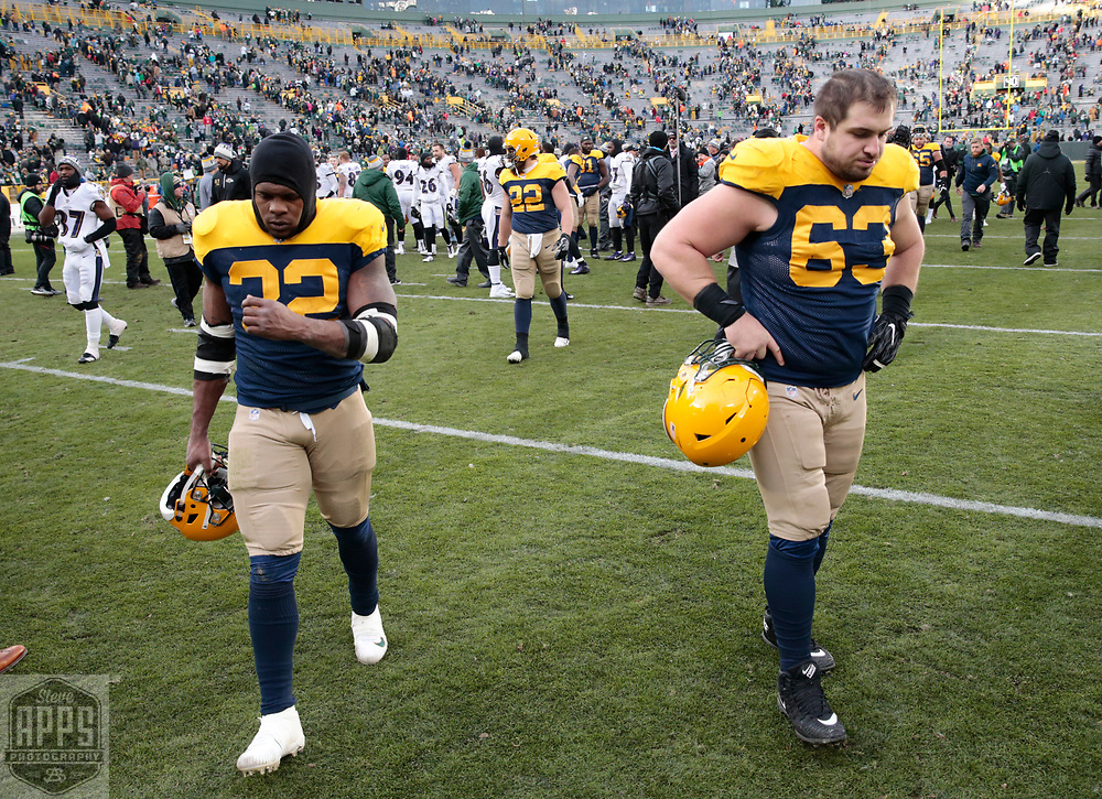 Green Bay Packers running back Devante Mays (32) and Green Bay Packers center Corey Linsley (63) walk off the field after losing to the Ravens. <br /> The Green Bay Packers hosted the Baltimore Ravens at Lambeau Field Sunday, Nov. 19, 2017. The Packers lost 23-0. STEVE APPS FOR THE STATE JOURNAL.