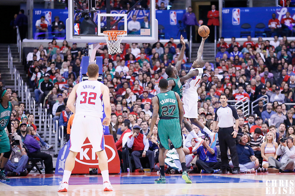 08 January 2014: Los Angeles Clippers shooting guard Jamal Crawford (11) goes for the lay up over Boston Celtics small forward Jeff Green (8) during the Los Angeles Clippers 111-105 victory over the Boston Celtics at the Staples Center, Los Angeles, California, USA.