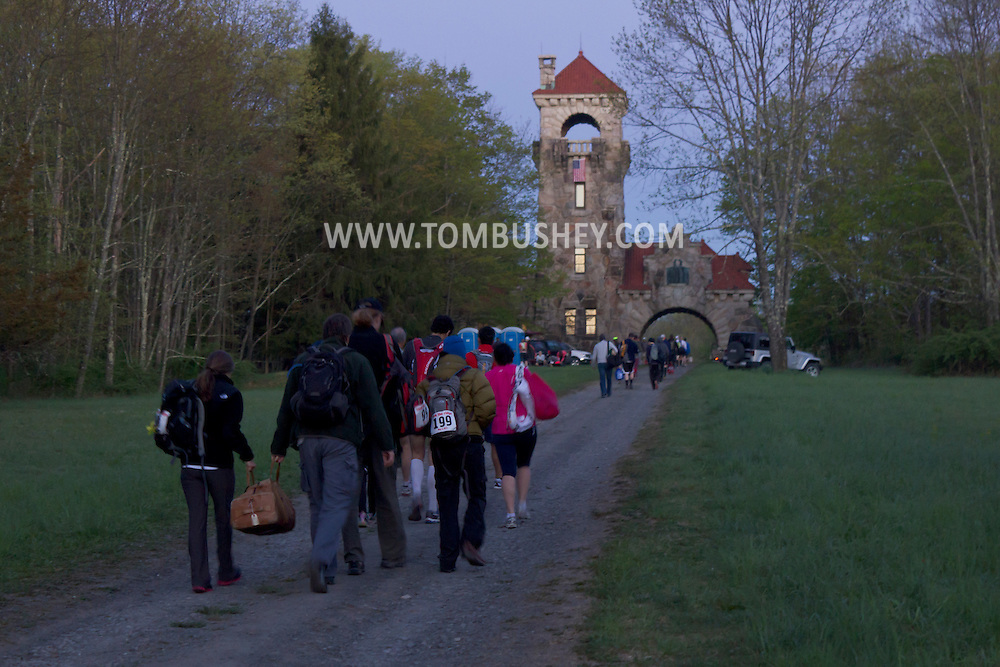 Gardiner, New York - Runners walk to the Gatehouse before dawn for the Rock the Ridge 50-mile endurance challenge race at the Mohonk Preserve on May 4, 2013. The race is part of Mohonk's 50th anniversary celebration and a fundraiser for the preserve.