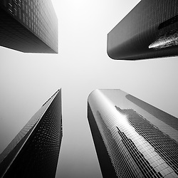 Los Angeles skyscraper  buildings black and white picture.  View is of four office buldings looking upward toward the sky. High resolution photo was taken in 2012.