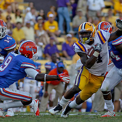 October 8, 2011; Baton Rouge, LA, USA;  LSU Tigers running back Alfred Blue (4) avoids Florida Gators safety Joshua Shaw (9) during the second half at Tiger Stadium. LSU defeated Florida 41-11. Mandatory Credit: Derick E. Hingle-US PRESSWIRE / © Derick E. Hingle 2011