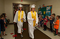 "Graduating Laconia High School seniors ""walk the halls"" greeted by pomp and circumstance from current kindergarteners at Pleasant Street School on Thursday afternoon.  (Karen Bobotas/for the Laconia Daily Sun)"