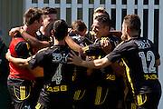 Team Wellington players celebrate. Team Wellington v Hawkes Bay United, ASB Premiership semi final at David Farrington Park, Wellington. 8 March 2014. Photo: Cameron McIntosh/www.photosport.co.nz