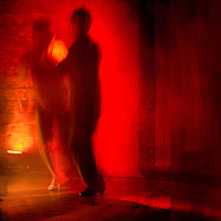 A couple dancing the Tango in a cabaret