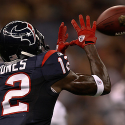 August 21, 2010; New Orleans, LA, USA; Houston Texans wide receiver Jacoby Jones (12) catches a pass during the second half of a 38-20 win by the New Orleans Saints over the Houston Texans during a preseason game at the Louisiana Superdome. Mandatory Credit: Derick E. Hingle