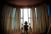 A refugee young girl opens the window at YMCA relief comittee in Orissa's capital Bhubaneswar. Nov. 04, 2008..