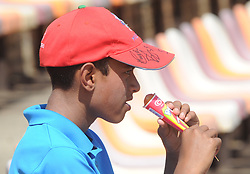 Johannesburg 19-12-18. South Africa Invitation XI vs Pakistan. Pakistan open their tour of South Africa with a three-day match at Sahara Willowmoore Park, Benoni. Day 1, afternoon session.  Man Rao from England cools down with eating an ice cream. Picture: Karen Sandison/African News Agency(ANA)