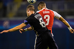 Kieran Gibbs #3 of Arsenal F.C. vs Ivo Pinto #6 of GNK Dinamo Zagreb during football match between GNK Dinamo Zagreb, CRO and Arsenal FC, ENG in Group F of Group Stage of UEFA Champions League 2015/16, on September 16, 2015 in Stadium Maksimir, Zagreb, Croatia. Photo by Ziga Zupan / Sportida