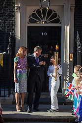 © licensed to London News Pictures. London, UK 26/07/2012. David and Samantha Cameron meets Kate Nesbitt who carries the torch to Downing Street. Photo credit: Tolga Akmen/LNP