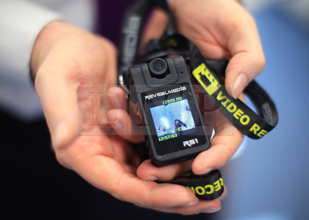 ***LNP BEST OF WEEK SELECTION*** © Licensed to London News Pictures. London, UK.08/05/2014. London, UK.  (FILED PICTURE: 23/01/14) A police officer holds one of the video cameras, which from today have been introduced in London by the Metropolitan Police as a part of a trial aimed at increasing trust and speeding up justice for victims .Photo credit: LNP