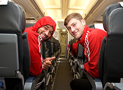 ZENICA, BOSNIA & HERZEGOVINA - Sunday, October 11, 2015: Wales' Ashley 'Jazz' Richards and Ben Davies on the team's return flight to Cardiff after qualifying for the UEFA Euro 2016 finals despite a 2-0 defeat to Bosnia and Herzegovina during the UEFA Euro 2016 qualifying match. (Pic by David Rawcliffe/Propaganda)
