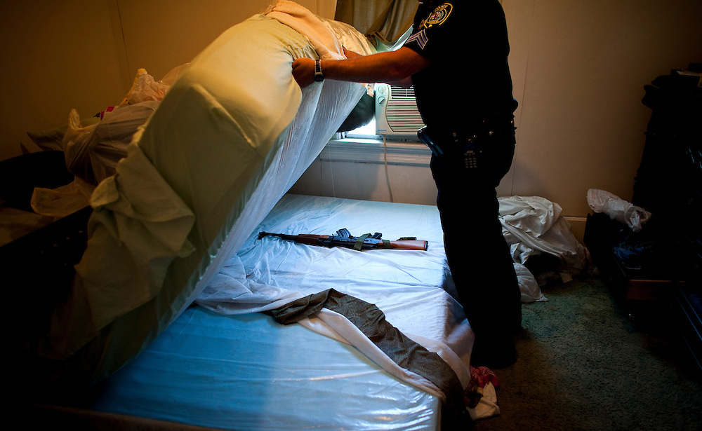 Based on confidential informant information The Milwaukee Police find an AK-47 along with drugs hidden in this home.