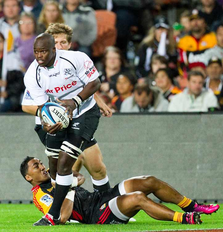 Sharks' Lubabalo Mtembu beats off a challenge from Chiefs' Bundee Aki in a Super Rugby match, Waikato Stadium, Hamilton, New Zealand, Saturday, April 27, 2013.  Credit:SNPA / David Rowland