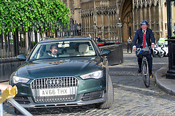 © Licensed to London News Pictures. 12/06/2017. London, UK. NICHOLAS SOAMES MP (left) and ANDREW MITCHELL MP (right) seen leaving the Houses of Parliament in a car and on a bike, following a 1922 Committee meeting.  Over the weekend British prime minister Theresa May formed a new cabinet and continues discussions with the DUP in an attempt to form a new government. Photo credit: Ben Cawthra/LNP