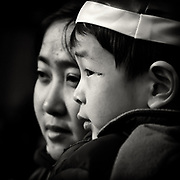 A chinese mother and boy looking to the left during Chinese New Year in Rotterdam, The Netherlands.
