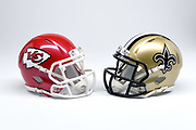 Detailed view of Kansas City Chiefs and New Orleans Saints helmets.