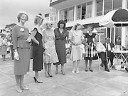 """Best Dressed Lady at Phoenix Park Races.1984..11.08.1984..08.11.1984.11th August 1984..A competition,sponsored by V'Soske Joyce,was held at the Phoenix Park Racecourse,Dublin.The prize of a hand tufted rug was awarded to the """"Best Dressed Lady"""" on Ladies Day at the racecourse. The eventual winner was Brianne Leary from Los Angeles,California..Image of the lady finalists as they line up for the judges at Phoenix Park Racecourse. (L-R),.Ms Carmel Healy,Oughterard,Galway,.Ms Colette Hayes,Castleknock,Dublin,.Ms Carmen Kealy,Clane,Kildare,.Ms Helen Cuddy,Howth,Dublin,.Ms Brianne Leary,Los Angeles,California and.Ms June Cosgrove,Kildare."""