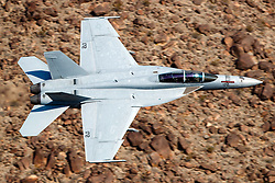 United States Navy Boeing F/A-18F Super Hornet (NJ 172) from the VFA-122 Flying Eagles squadron flies low level on the Jedi Transition through Star Wars Canyon / Rainbow Canyon, Death Valley National Park, Panamint Springs, California, United States of America