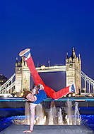 Break-dancer performing a move in front of Tower Bridge, London. Photographed for Visit Britain as part of their Youth Culture campaign. THIS IMAGE IS COPYRIGHT VISIT BRITAIN.