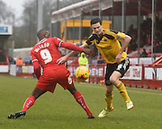 Jamie Murphy fights for the ball with Izale McLeod during the Sky Bet League 1 match between Crawley Town and Sheffield Utd at Broadfield Stadium, Crawley, England on 28 February 2015. Photo by David Charbit.
