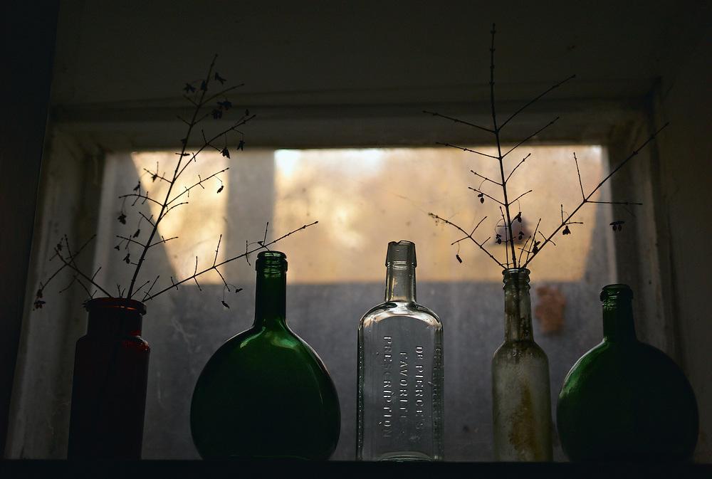 Old bottles on basement window sill