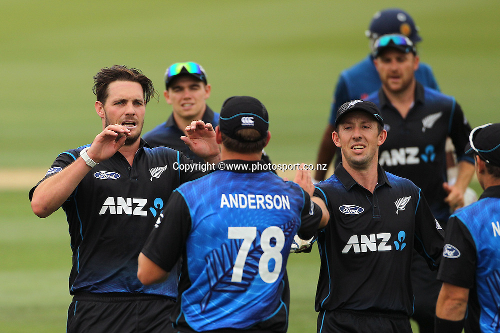 Mitchell McClenaghan of the Black Caps is congratulated by Corey Anderson after dismissing Mahela Jayawardene of Sri Lanka during the first ODI between the Black Caps v Sri Lanka at Hagley Oval, Christchurch. 11 January 2015 Photo: Joseph Johnson / www.photosport.co.nz