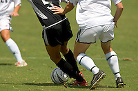 Woman's soccer match action