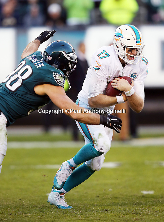 Philadelphia Eagles outside linebacker Connor Barwin (98) sacks Miami Dolphins quarterback Ryan Tannehill (17) on third down, forcing a punt on the next play that gives the Eagles one last offensive series with less than two minutes left in the fourth quarter during the 2015 week 10 regular season NFL football game against the Miami Dolphins on Sunday, Nov. 15, 2015 in Philadelphia. The Dolphins won the game 20-19. (©Paul Anthony Spinelli)